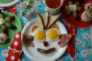 15570199-funny-christmas-breakfast-with-christmas-tree-and-snowman-made-stock-photo