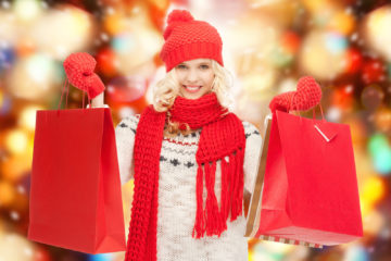 holidays, sale, shopping, christmas concept - beautiful teenage girl in winter clothes with shopping bags