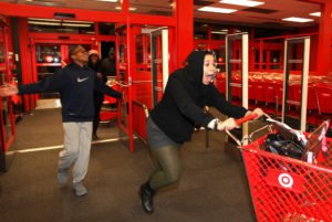 In this Thursday evening, Nov. 22, 2012 photo, Bianca Ward, 20, screams as she enters a Target store in Chesapeake, Va. Hundreds of people lined up early for the Thanksgiving Day sale. Ward had waited in line since the afternoon. (AP Photo/The Virginian-Pilot, Ross Taylor) MAGS OUT