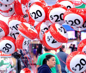 Balloons at an Oakland, Calif., Walmart advertise sale prices to shoppers on Thursday, Nov. 24, 2011. Walmart opened their doors before midnight to encourage early shopping.(AP Photo/Noah Berger)
