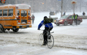Bicycle messengers in a snowstorm