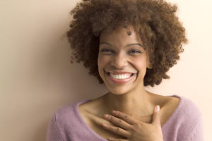 Flattered Woman Smiling --- Image by © Royalty-Free/Corbis